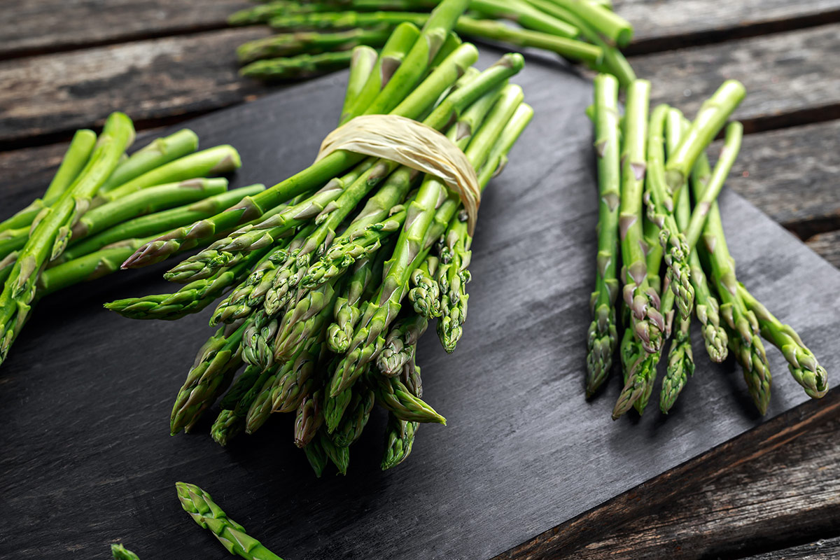 Green and white asparagus contain different enzymes and, like fresh salads and vegetables, are carbohydrates